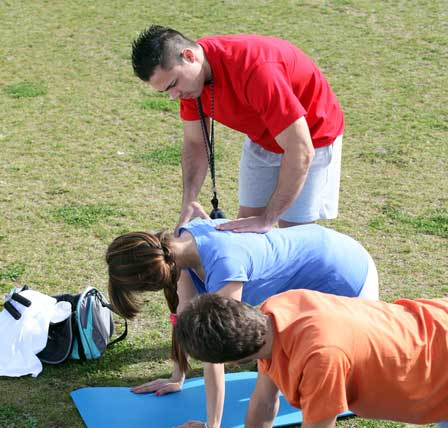 Personal Trainer working with clients